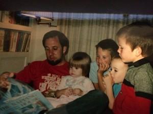 Victim John O'Friel reading to four of his children