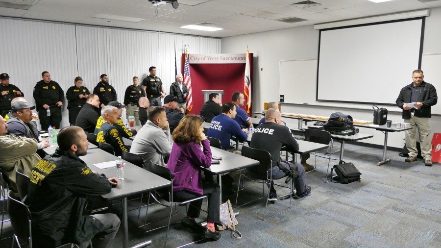 Law Enforcement personnel meet for briefing at the West Sacramento Police Department prior to the operation.