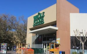 The image includes a photo of the Davis Whole Foods market.