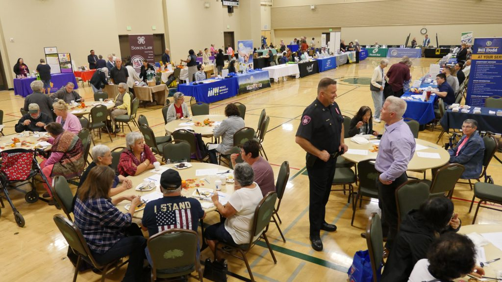 Yolo County District Attorney Jeff Reisig and Woodland Police Department Deputy Chief Derek Kaff welcoming seniors to the 11th annual senior resource and crime prevention fair.