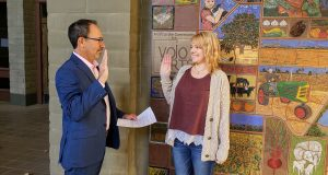 The image includes Jessie Tessler being sworn in by Jonathan Raven.