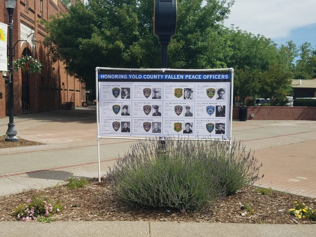 Image is a photo of the fallen peace officer memorial banner posted in Heritage Plaza, Woodland, CA.